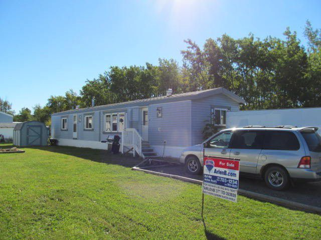 Main Photo: 52 7414 FOREST LAWN Street in Fort St. John: Fort St. John - Rural E 100th Manufactured Home for sale (Fort St. John (Zone 60))  : MLS®# N230634