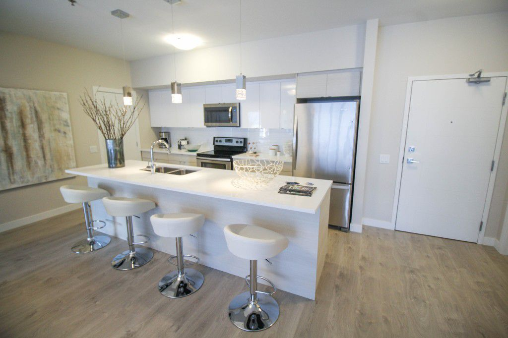 Beautiful finishes throughout your new home including this large island with quartz counter tops & pendant lighting.