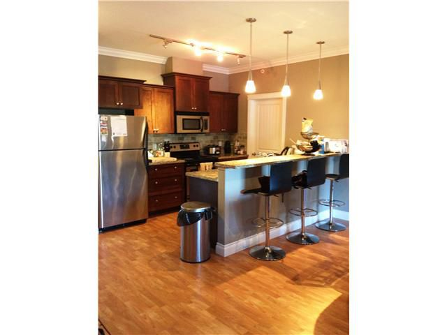 "Main Photo: 407 12268 224TH Street in Maple Ridge: East Central Condo for sale in ""STONE GATE"" : MLS®# V1016552"