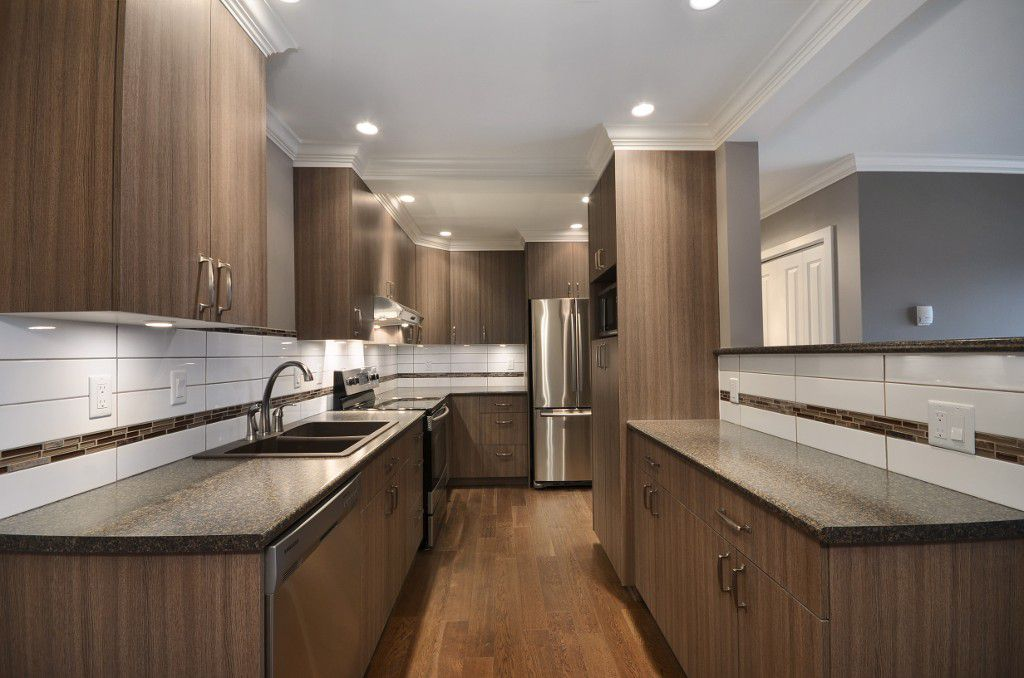 """Main Photo: 317 9101 HORNE Street in Burnaby: Government Road Condo for sale in """"WOODSTONE"""" (Burnaby North)  : MLS®# V988687"""