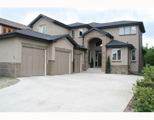 Fabulous Curb Appeal!  Backing onto private green space!