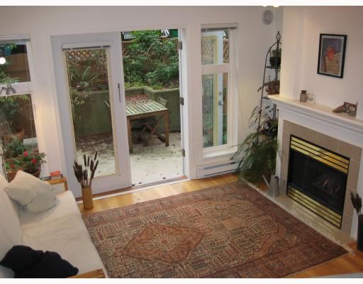 """Main Photo: 215 2545 W BROADWAY BB in Vancouver: Kitsilano Townhouse for sale in """"TRAFALGAR MEWS"""" (Vancouver West)  : MLS®# V745941"""