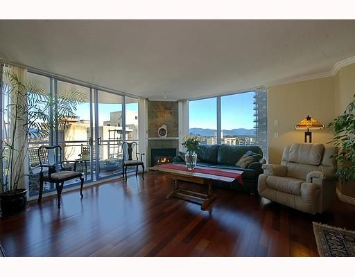 Bright, spacious living room with S/D to 1st balcony boasting CITY and MOUNTAIN VIEWS!
