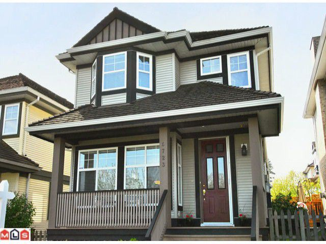 "Main Photo: 5723 148B Street in Surrey: Sullivan Station House for sale in ""Panorama Village"" : MLS®# F1010272"