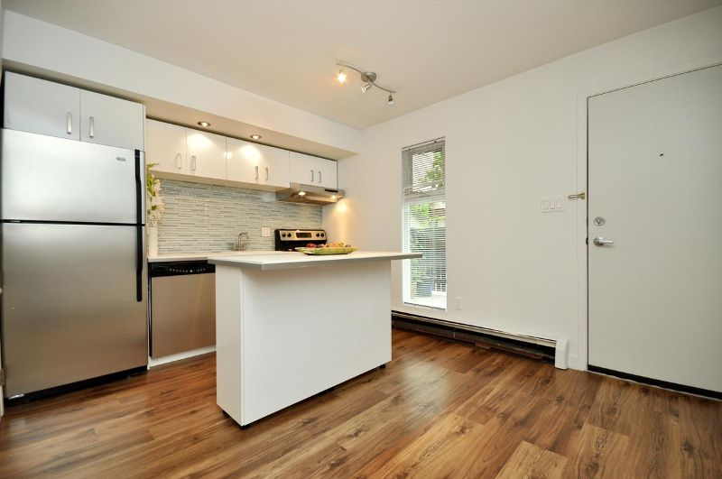 """Main Photo: # 33 870 W 7TH AV in Vancouver: Fairview VW Townhouse for sale in """"LAUREL COURT"""" (Vancouver West)  : MLS®# V786328"""
