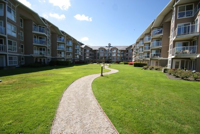 "Main Photo: 205 5880 DOVER Crescent in Richmond: Riverdale RI Condo for sale in ""WATERSIDE"" : MLS®# R2068298"