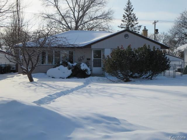 Lovingly Cared For 1074 Sq.ft. Bungalow situated on a Quiet Crescent with Newer Shingles, Eaves (04), Soffit & Fascia.