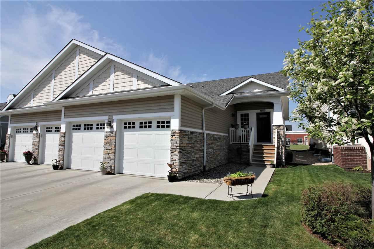 Main Photo: 4344 VETERANS Way in Edmonton: Zone 27 House Half Duplex for sale : MLS®# E4158621