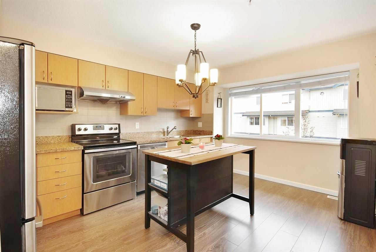 """Main Photo: 10 1268 RIVERSIDE Drive in Port Coquitlam: Riverwood Townhouse for sale in """"SOMERSTON"""" : MLS®# R2029781"""