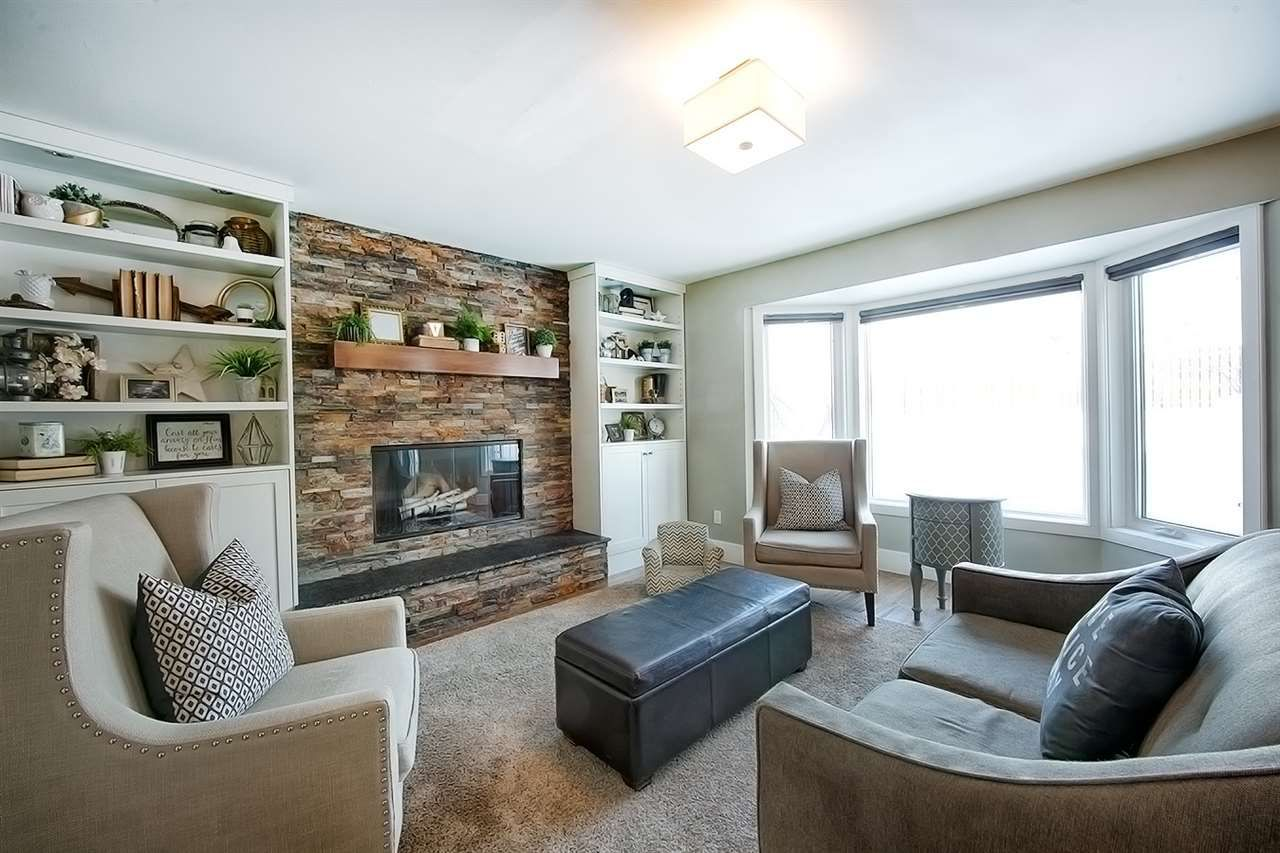 This perfect family room provides natural light and a cozy setting with built in cabinetry and a slate covered fireplace.