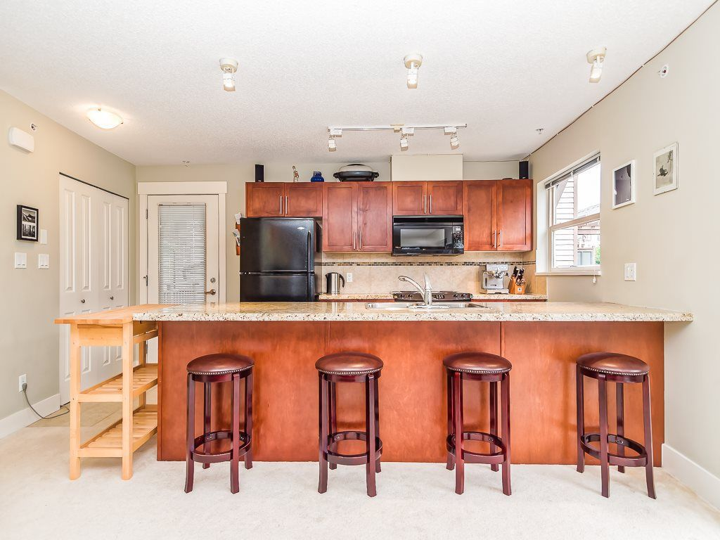 "Main Photo: 205 1174 WINGTIP Place in Squamish: Downtown SQ Condo for sale in ""Talon at Eaglewind"" : MLS®# R2240739"