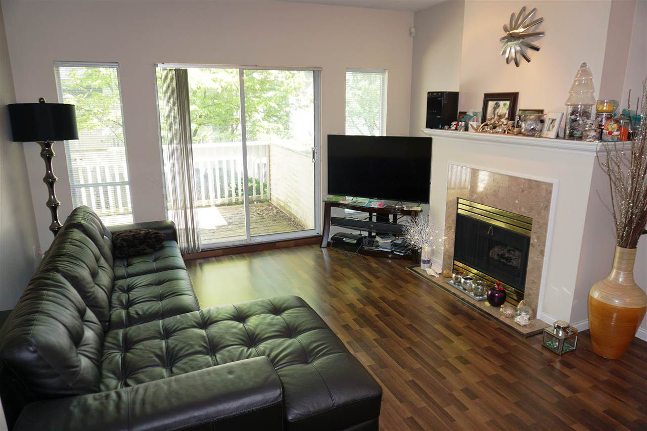 Spacious living room features gas fireplace, large balcony on one side,and formal dining area on the other side