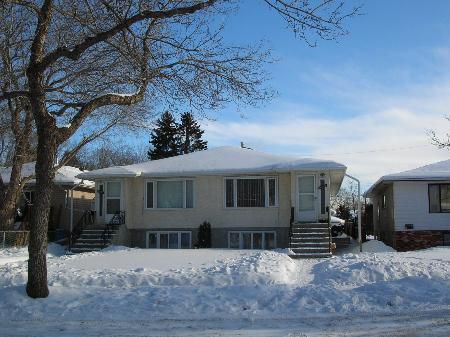 Main Photo: PENDING SALE! Side by Side Duplex with 4 Suites