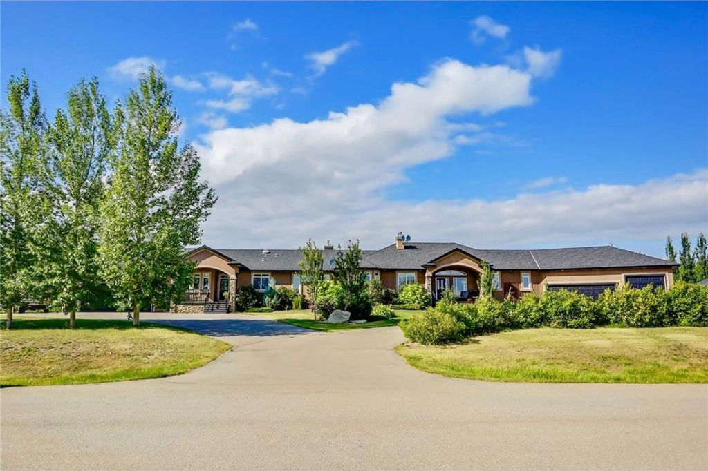 Welcome to 116 East Ridge Dr. A private 2.02 acre lot, located on a quiet cul-de-sac, nestled into hundreds of trees and bushes. This 3374 sq foot bungalow features over 6600 sq ft of finished living space including a completely self contained side-by-sid
