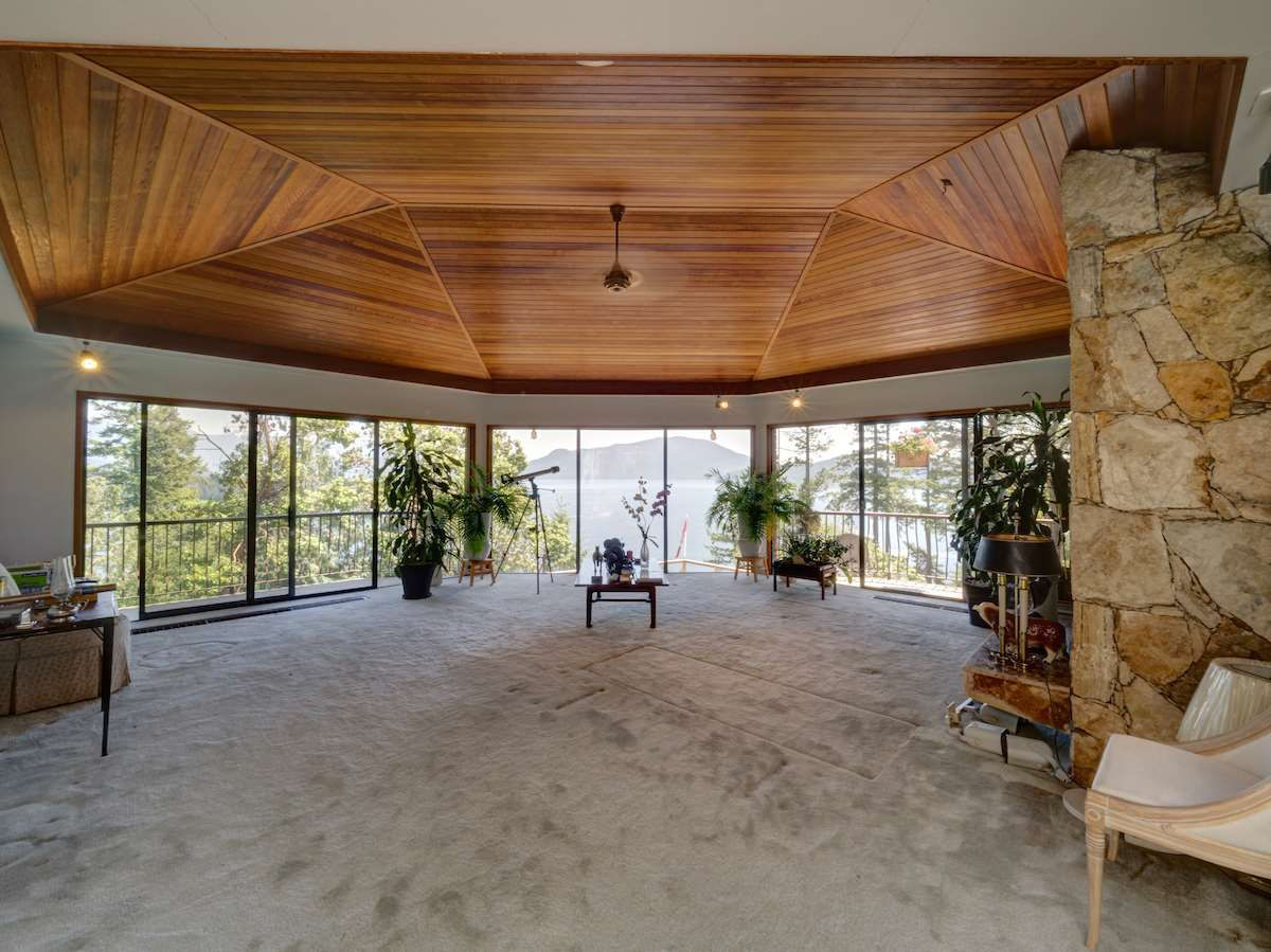 Entrance opens to beautiful vaulted ceiling living room with expansive ocean and mountain views
