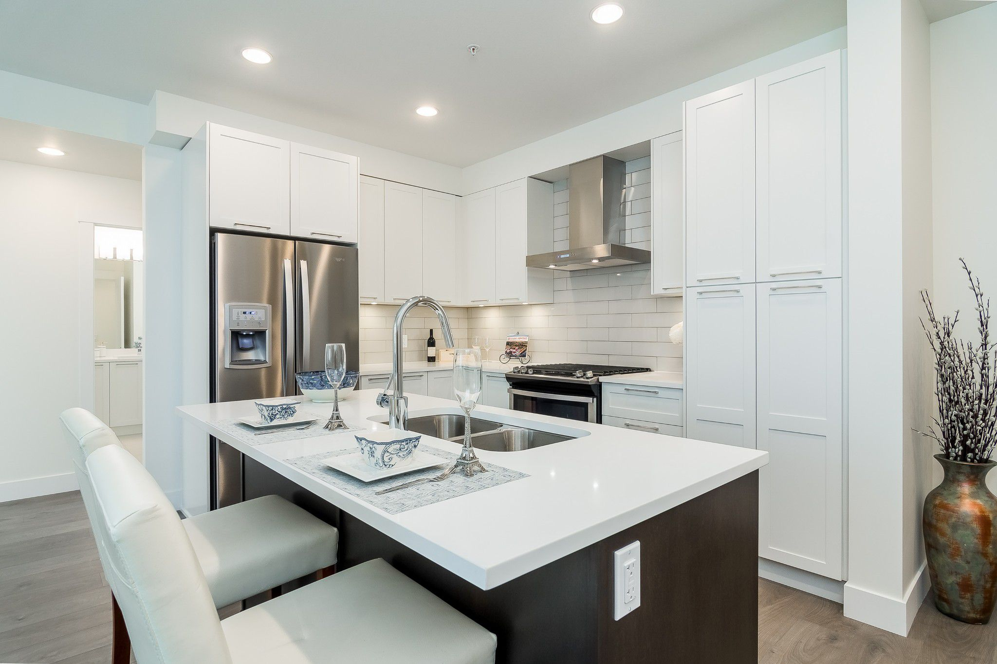 Welcome to #211 - 22087 49 Avenue, Langley, BC in the sought-after luxurious Belmont by Infinity!