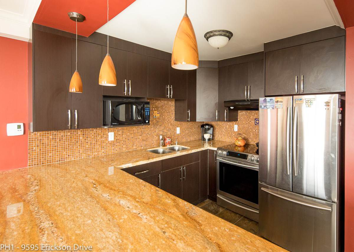 The Kitchen has newer stainless appliances and a very nice Granite Counter Top with a large bar seating area for entertaining.