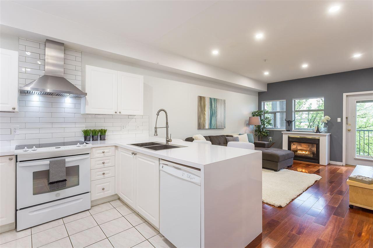 "Main Photo: 105 1591 BOOTH Avenue in Coquitlam: Maillardville Condo for sale in ""Le Laurentien"" : MLS®# R2361074"