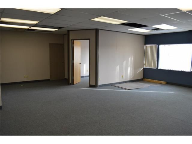 Main Photo: 1207 213 THIRD Avenue in Strathmore: A-ST_DTN Office for lease : MLS®# C1023358