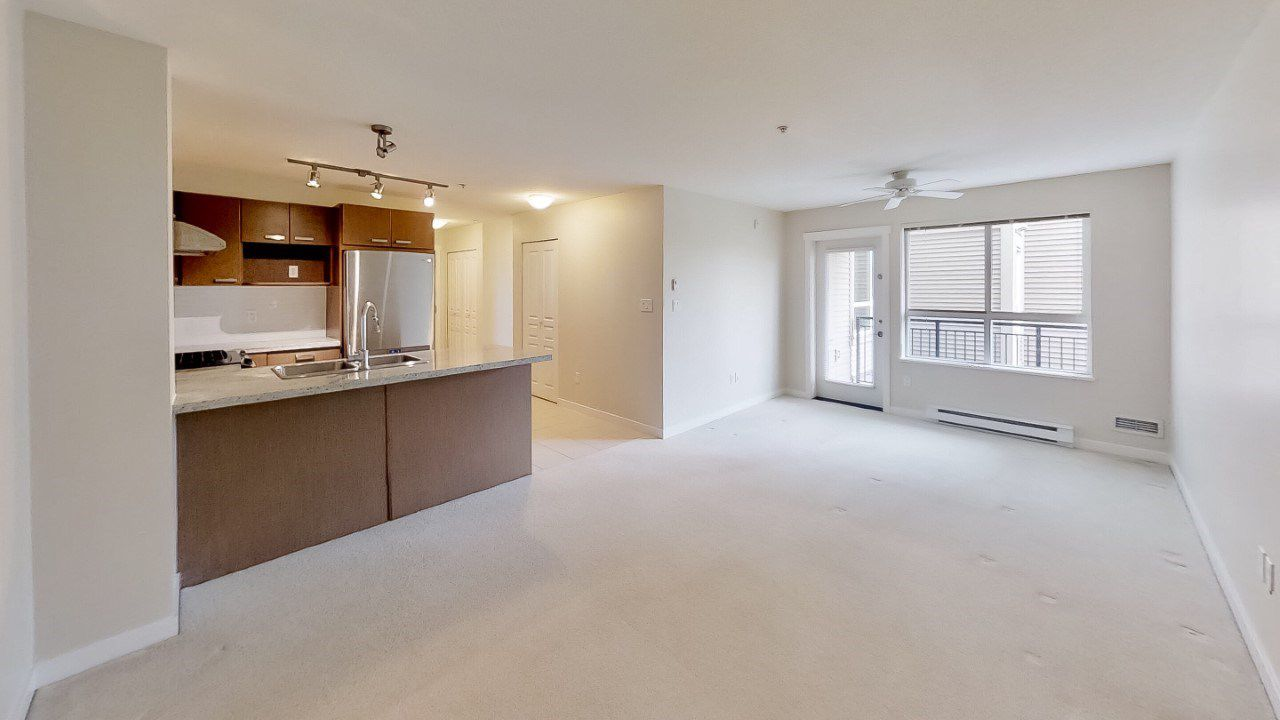 "Main Photo: 221 9500 ODLIN Road in Richmond: West Cambie Condo for sale in ""CAMBRIDGE PARK"" : MLS®# R2358525"