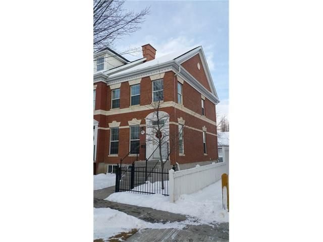 Beautiful European style brick townhouse. Corner unit with windows on the side for more sunlight!
