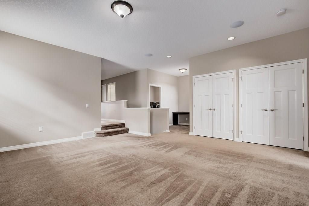 Photo 17: Photos: 265 AUBURN GLEN Manor SE in Calgary: Auburn Bay House for sale : MLS®# C4181161