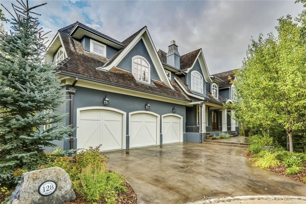 Main Photo: 128 POSTHILL Drive SW in Calgary: Springbank Hill House for sale : MLS®# C418744