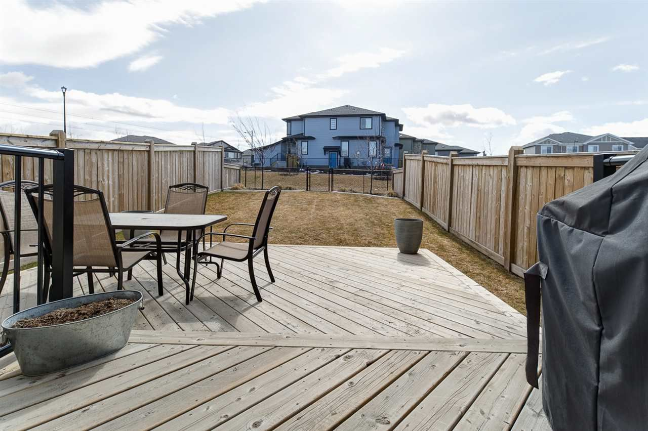 South facing backyard backing a quiet walking trail. Large two tiered deck and beautiful landscaping