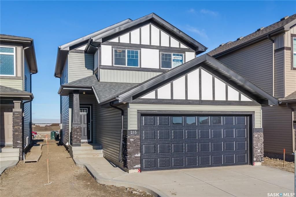 Main Photo: 215 Dagnone Lane in Saskatoon: Brighton Residential for sale : MLS®# SK748870