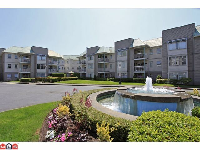 Main Photo: 311 9763 140TH Street in Surrey: Whalley Condo for sale (North Surrey)  : MLS®# F1217814
