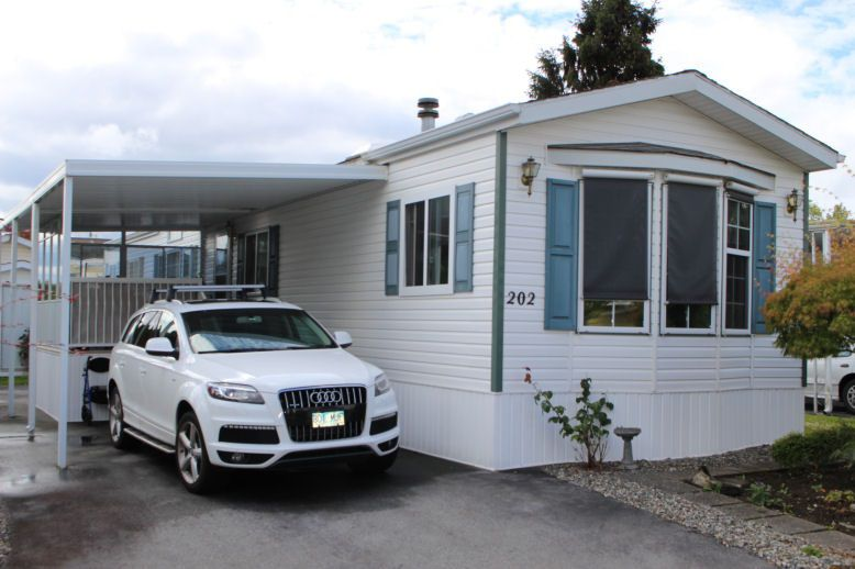 "Main Photo: 202 1840 160 Street in Surrey: King George Corridor Manufactured Home for sale in ""BREAKAWAY BAYS"" (South Surrey White Rock)  : MLS®# R2089567"