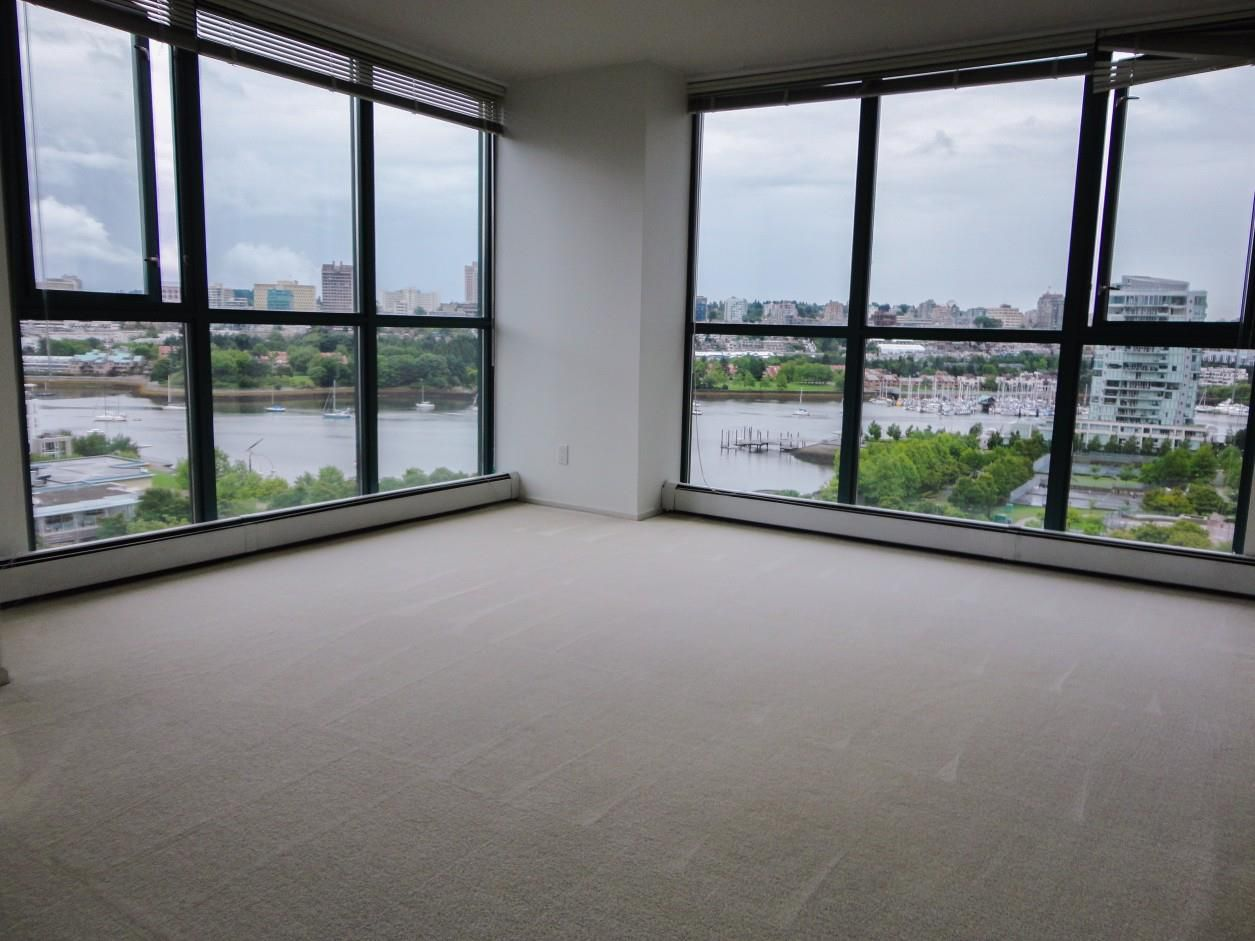 Unobstructed False Creek water view and David Lam Park from the living room in this 2bdrm + den corner suite!  Photo provided by Seller, taken prior to tenant moved in. Excellent tenant, fixed tenancy till 12/31/2016.