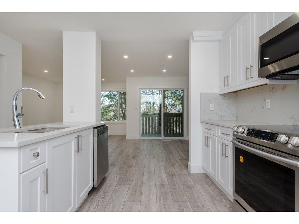 """Main Photo: 595 CARLSEN Place in Port Moody: North Shore Pt Moody Townhouse for sale in """"EAGLE POINTE"""" : MLS®# R2227952"""
