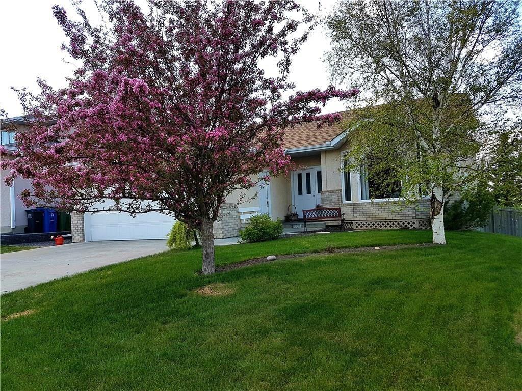 Main Photo: 77 WEST EDGE Road: Cochrane House for sale : MLS®# C4177581