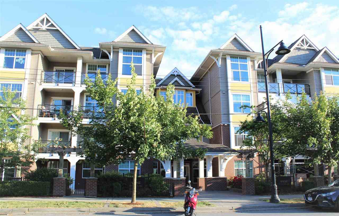 "Main Photo: 301 17712 57A Avenue in Surrey: Cloverdale BC Condo for sale in ""WEST ON THE VILLAGE WALK"" (Cloverdale)  : MLS®# R2276468"