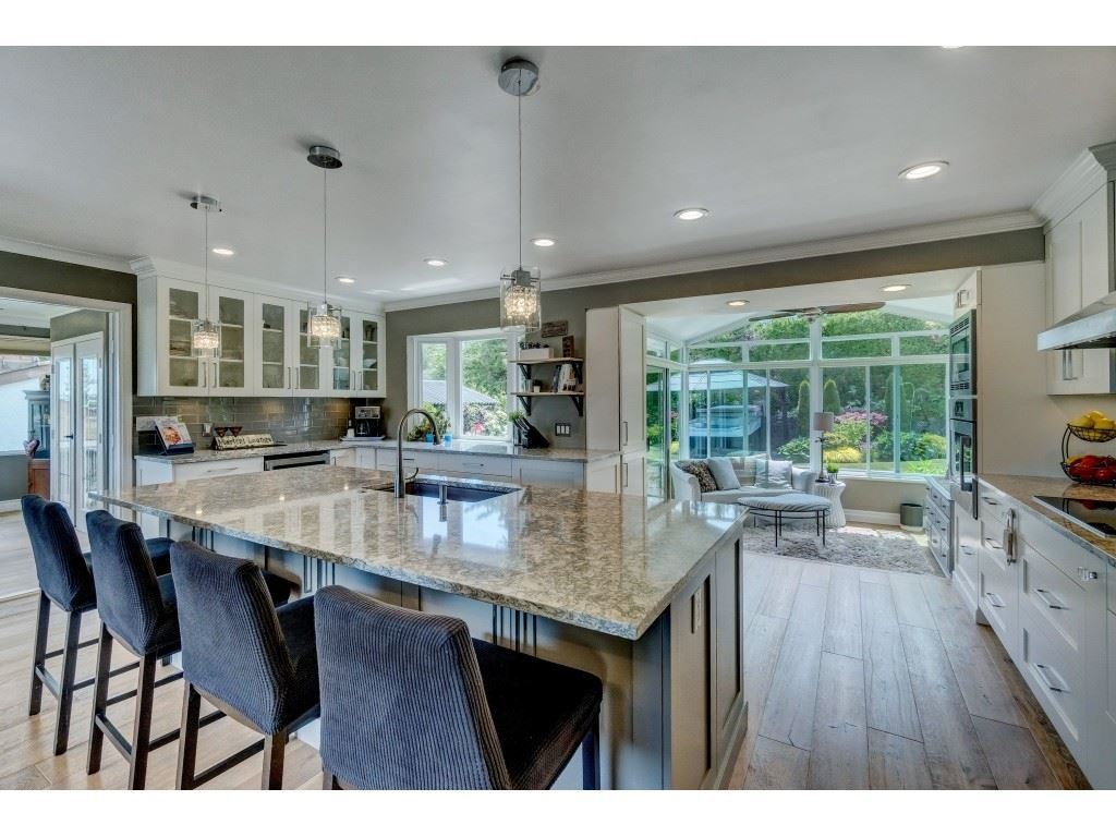 Significantly-upgraded Great Room features Italian wide-plank engineered hardwood, a 10-foot Island with Breakfast bar and stunning views of the mountains and valley