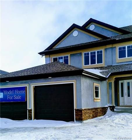 BRIGHT, SPACIOUS & NICELY UPGRADED WITH A 22' X 22' GARAGE AND JUST STEPS TO THE HARTE TRAIL! STUCCO WILL BE DONE SOON!