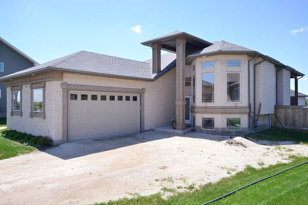 """SENSATIONAL 1200sf Raised Bungalow Custom Built by """"Foster Built Homes"""" '08 on Landscaped & Fenced pie lot in Town of Oakbank. Home features 2 bedrooms up & 1 in Fully Finished Basement."""