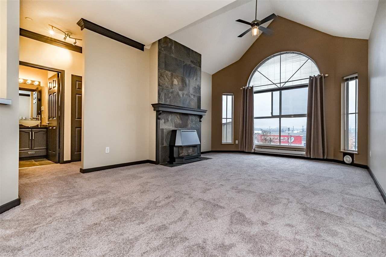 "Main Photo: 406 12464 191B Street in Pitt Meadows: Mid Meadows Condo for sale in ""LASEUR MANOR"" : MLS®# R2319773"