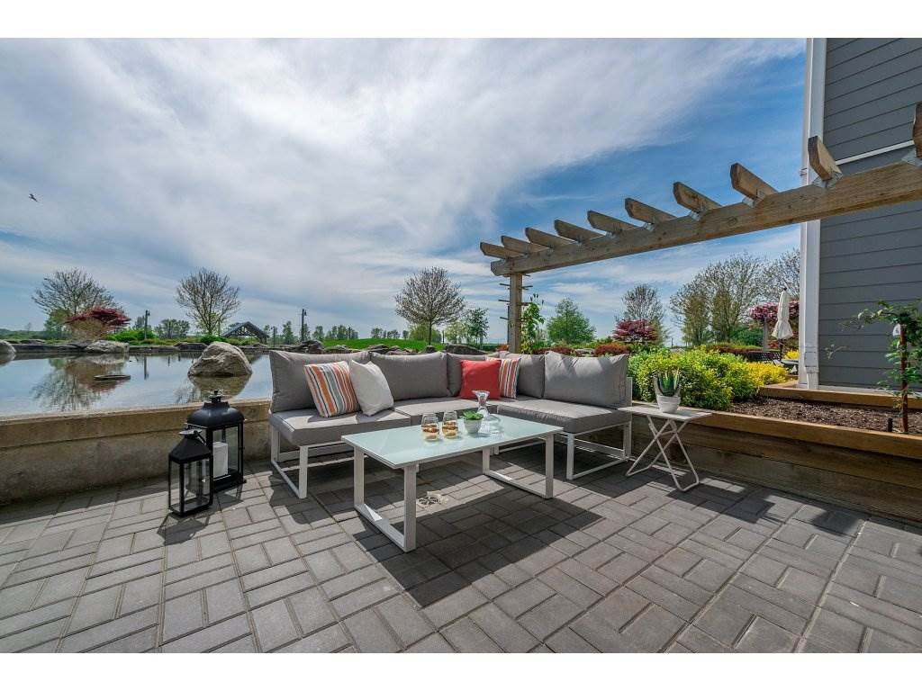 "Main Photo: 102 4500 WESTWATER Drive in Richmond: Steveston South Condo for sale in ""COPPER SKY WEST"" : MLS®# R2266032"