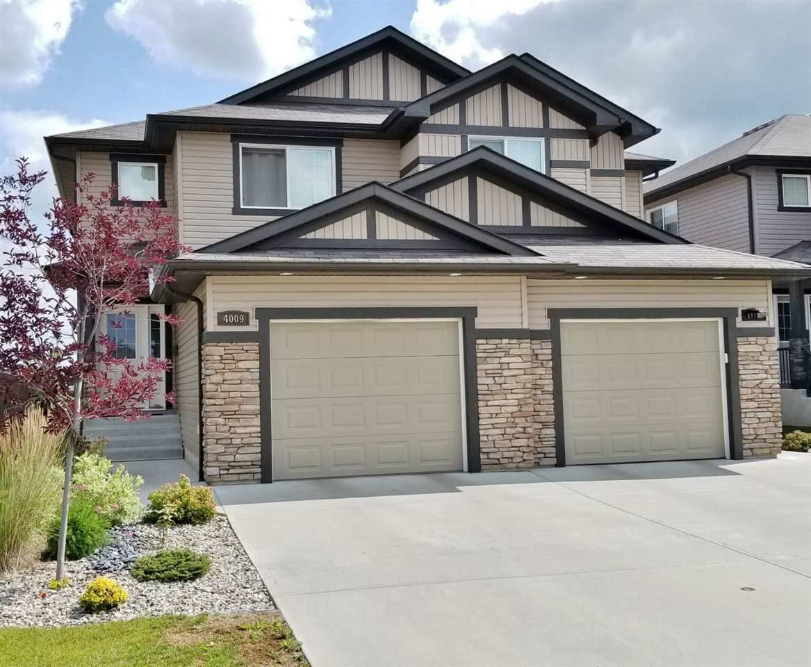 Welcome to 4009-6 Strett NW, an amazing family home backing onto a greenbelt!