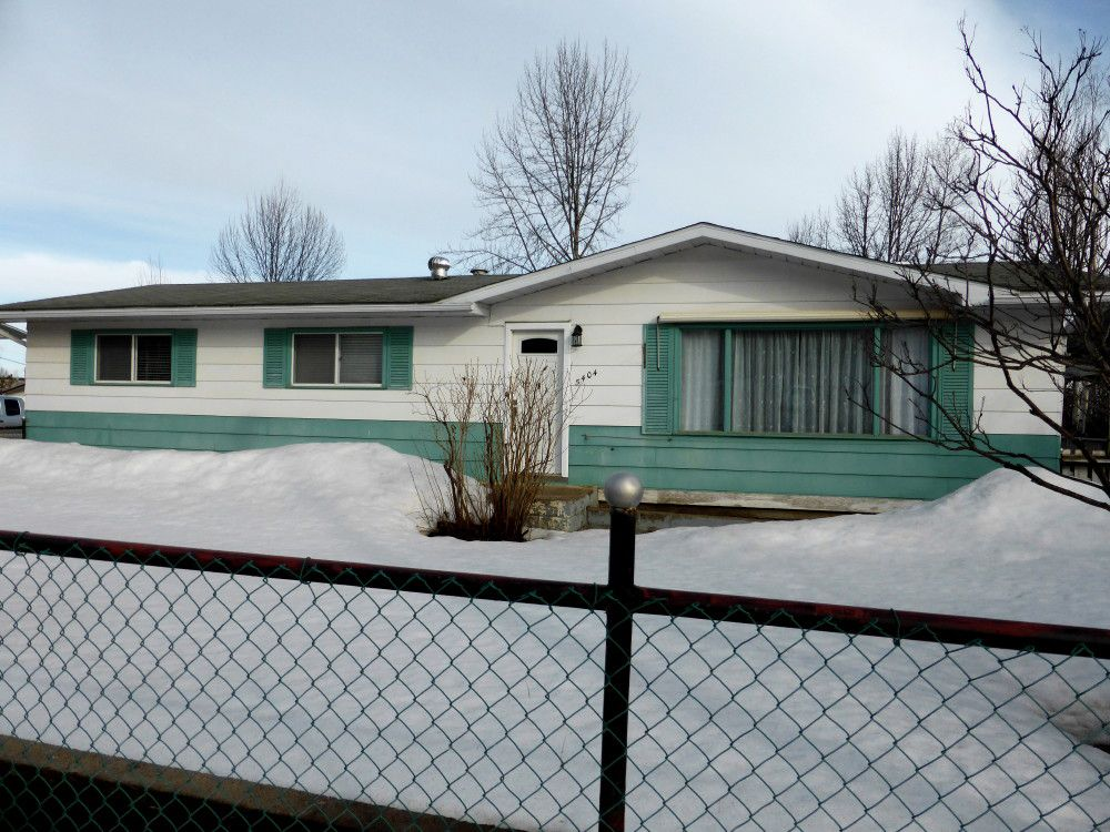 On a centrally located 73'x160' yard, fully fenced in front and partially fenced at the rear