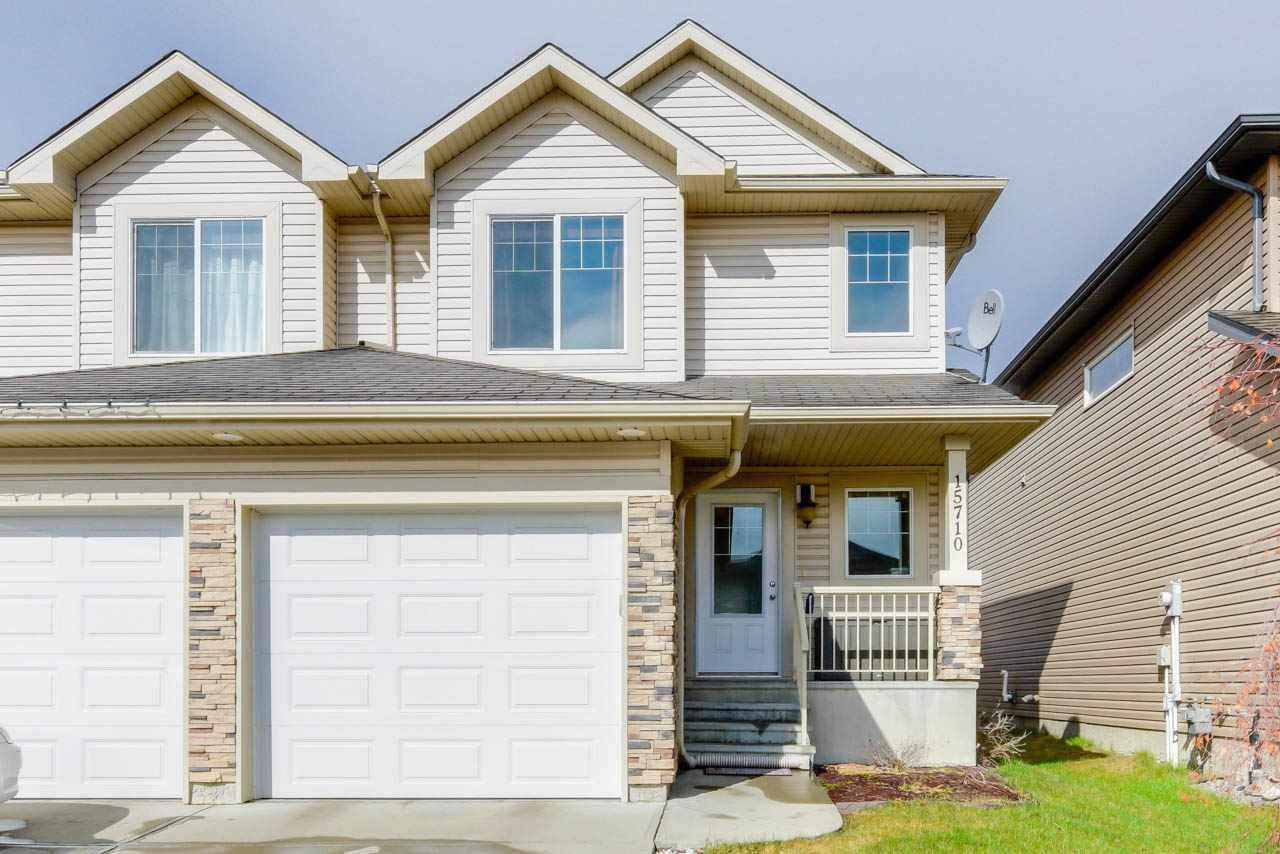 Main Photo: 15710 95 Street in Edmonton: Zone 28 House Half Duplex for sale : MLS®# E4155095