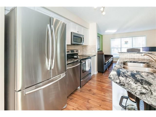 Main Photo: 101 PRESTWICK Heights SE in Calgary: McKenzie Towne House for sale : MLS®# C4092159