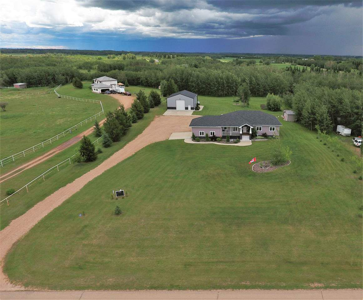 front aerial view of the property
