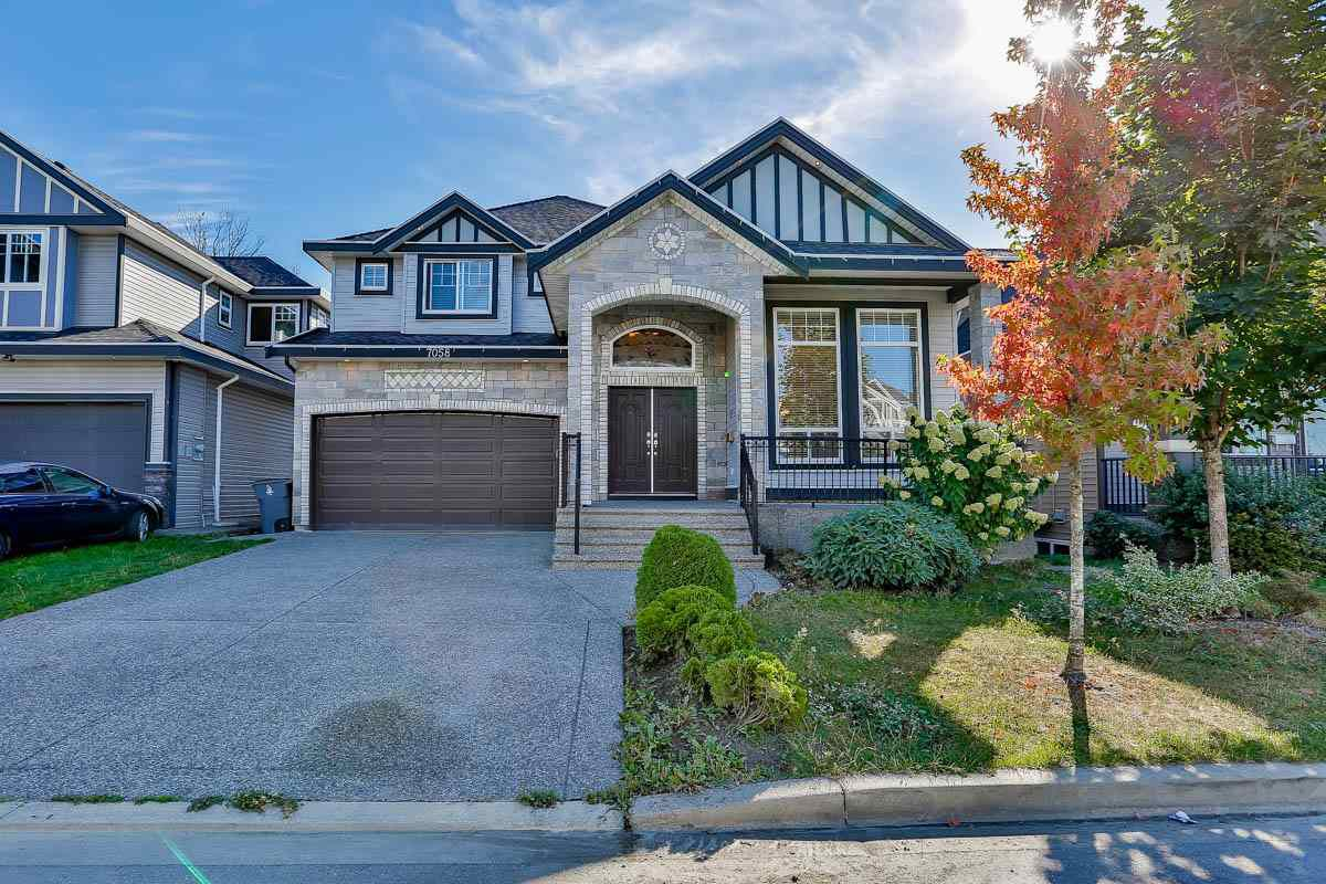 Main Photo: 7058 144B Street in Surrey: East Newton House for sale : MLS®# R2111190