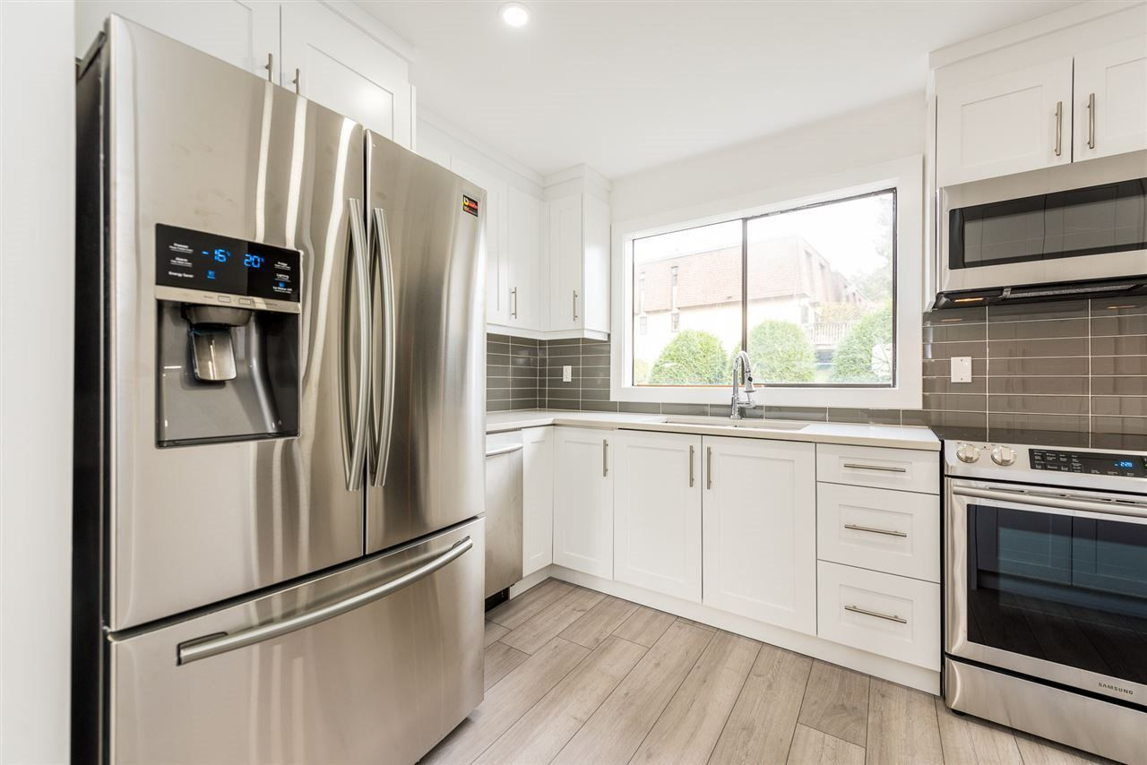 """Main Photo: 819 OLD LILLOOET Road in North Vancouver: Lynnmour Townhouse for sale in """"LYNMOUR VILLAGE"""" : MLS®# R2345013"""