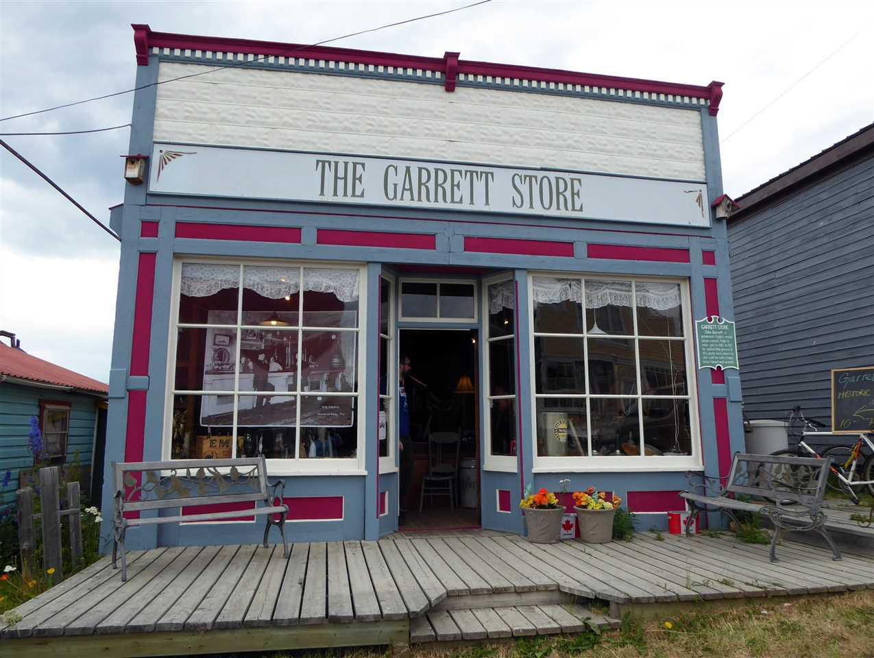 The Garret Store was built in 1917, after fire destroyed most of the town core and operated by John and Mary Garrett as a general store until 1941. They sold groceries, dry goods, raw furs and Mrs. Garrett's fresh baked bread.