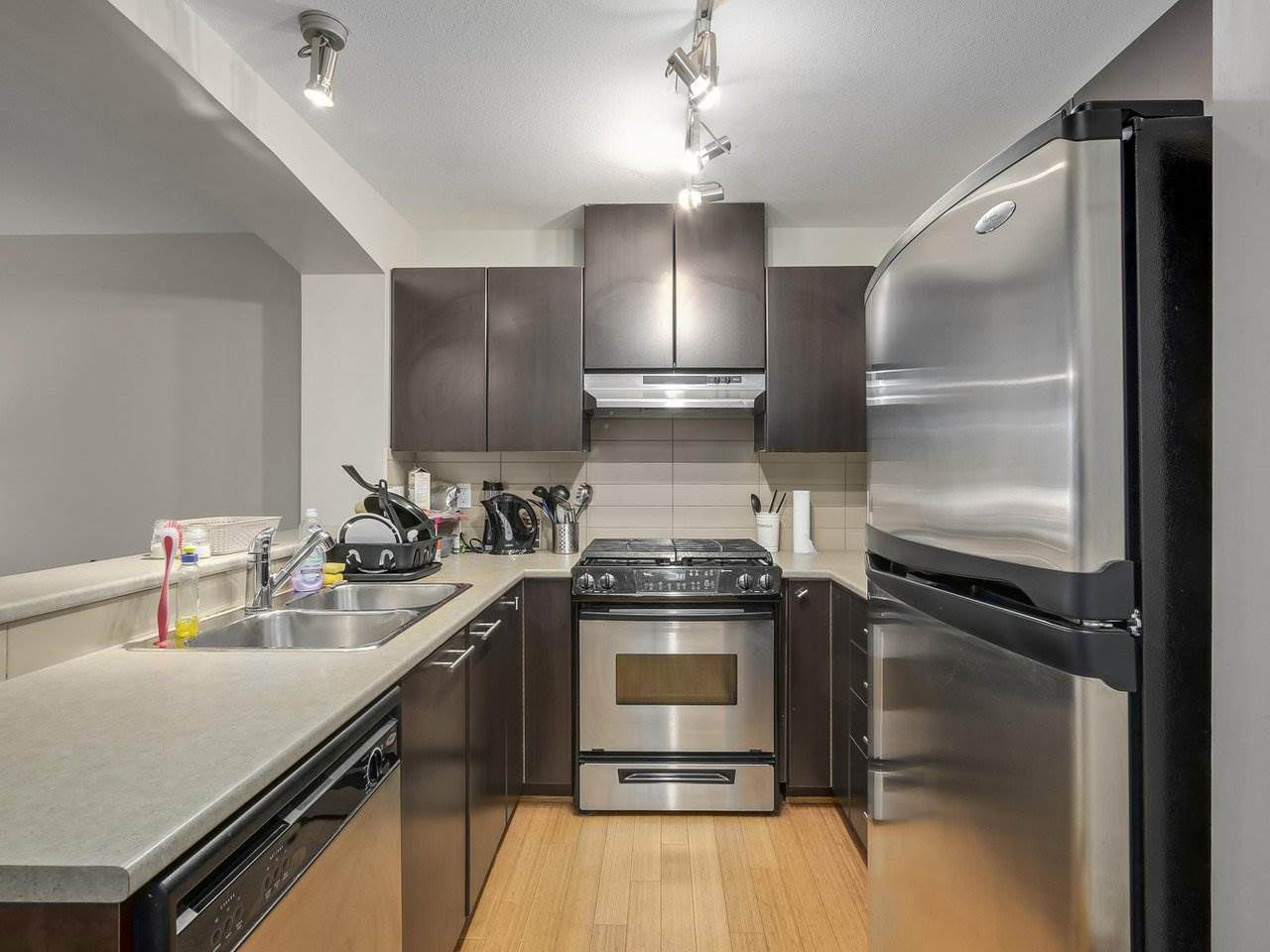 "Main Photo: 409 9319 UNIVERSITY Crescent in Burnaby: Simon Fraser Univer. Condo for sale in ""HARMONY AT THE HIGHLANDS"" (Burnaby North)  : MLS®# R2244427"