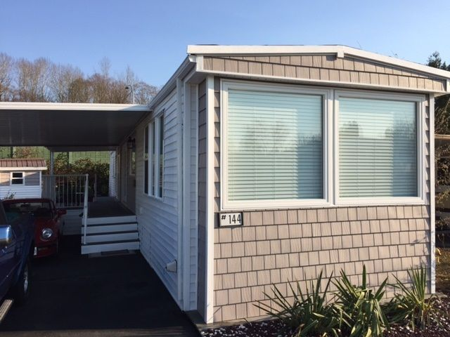 "Main Photo: 144 1840 160 Street in Surrey: King George Corridor Manufactured Home for sale in ""Breakaway Bays"" (South Surrey White Rock)  : MLS®# R2227579"